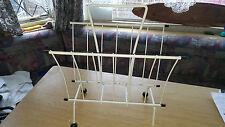 VINTAGE RETRO ? WHITE PLASTIC COATED MAGAZINE RACK WITH BLACK BOBBLE FEET