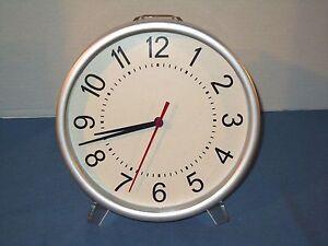 "Basic Wall Clock 9"" Dia. Quartz White/Silver Case 1 AA Battery"