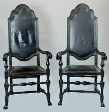 PAIR OF BAROQUE STYLE BLACK PAINTED LEATHER COVERED ARM CHAIRS
