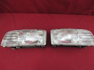 NOS OEM Buick Skylark Headlamp Light 1996 - 98 PAIR