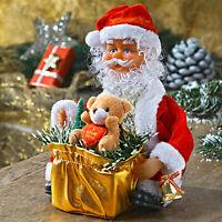 Weihnachtsmann mit Geschenkkorb und Bärchen, mit Musik und Bewegung