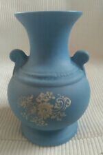 blue urn/ vase with white floral pattern