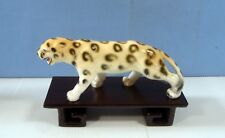 Hand crafted painted by Japanese artist porcelain leopard wood stand circa 1970s