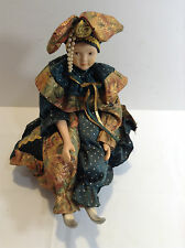Porcelain Musical Mardi Gras Doll on Rotating Pillow