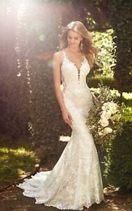 wedding dress with elegant lace, beading and sequins. Retail $3400