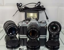 Canon AV-1 . Canon FD 50mm F 1.8 .Canon FD 28mm  F2.8 . Canon 135mm  F 3.5 Sc