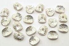 20 gebogene Metallscheiben geriffelt  ca. 9 x 8mm hellsilberfarben