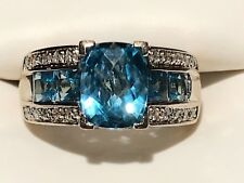 14KT WHITE GOLD BLUE TOPAZ AND NATURAL DIAMOND COCKTAIL BAND RING