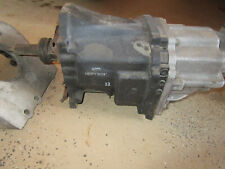 RED MOTOR HOLDEN ADAPTOR  AND TOYOTA  5 SPEED IRON BOX