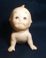Porcelain Kewpie Piano Baby doll