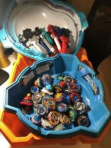 Large Beyblade burst collection (x50 Beys) + 3 Stadiums Launchers & Spare Parts