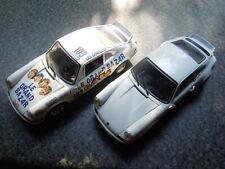 2 x seltene Porsche Carrera RS Sportwagenenmodelle von Universal Hobbies in 1:18
