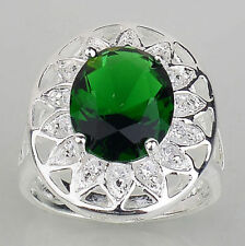 SILVER CLAW HELD GREEN STONE SURROUNDED BY CRYSTAL STONES CLUSTER FASHION RING