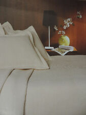Plain cream single throw over bedspread or sofa throw