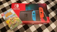Nintendo Switch Neon Red/Neon Blue Console and Animal Crossing Bundle *Brand New
