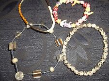 4 X ELASTICATED BRACELETS PLASTIC SPOTTED TIBES PEARL & DOLPHINS