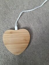 Wooden heart shaped wireless QI phone charger.
