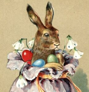 Frohliche Ostern Happy Easter postcard embossed rabbit in bag of eggs antique