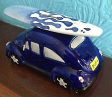Blue porcelain VW money box with surf board on the roof