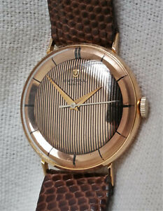 Vintage rare Universal Geneve mechanical watch, 18k solid gold, pinstripe dial