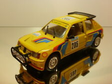 CBCAR PEUGEOT 205 TURBO 16 #205 PARIS ALGER DAKAR - YELLOW 1:24 - VERY GOOD