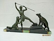 Sculpture couple chasseur ours blanc statue art deco Uriano Ugo Cipriani carving