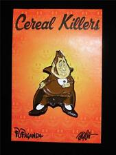 POPAGANDA: CEREAL KILLERS SERIES COUNT CALORIE LAPEL PIN BY RON ENGLISH