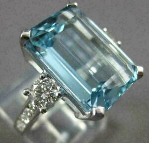 9Ct Emerald Cut Aquamarine Engagement Solitaire Ring 14K White Gold Over Silver.