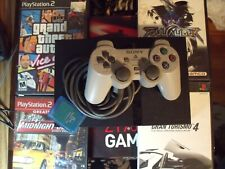 play station 2 slim ,2x8mb memory cards 1 controller and 4 games