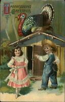 Thanksgiving - Boy & Girl Find Turkey on Roof of Pen #850 c1910 Postcard