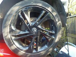 Vauxhall Corsa E black alloy wheel and tyre 215/45/17 No2
