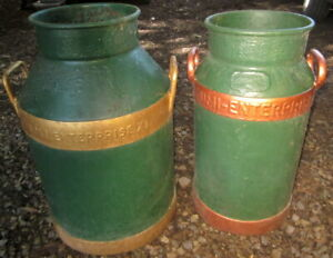 2 display only vintage iron milk cans - bottoms are rusted out .