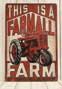 This is a Farmall Farm Tin Poster Rustic Vintage Look Sign Red Tractor Farmer