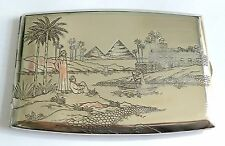 A VINTAGE 1930s STERLING SILVER CIGARETTE CASE WITH AN ENGRAVED EGYPTIAN SCENE