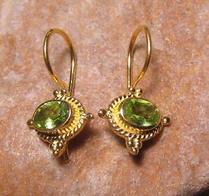 Sterling silver with 18k gold plate cut green PERIDOT gemstone earrings.