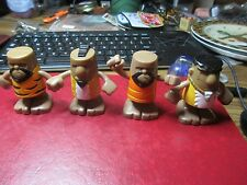 Four African American Caveman Toy Figures