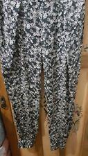 Excellent TRAFALUC ladies silky floral pants (size large)