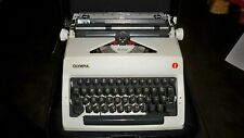 Vintage Olympia DeLuxe Portable Typewriter with case
