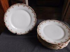 Suite de 8 assiettes à déssert porcelaine décor guirlandes fleuries