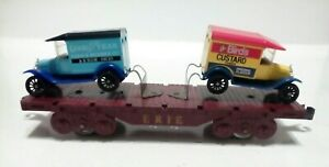 Marx O scale ERIE flat car with Matchbox ford vans , used , see pictures