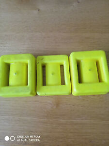 Two 2Kg and a single 1Kg diving lead weights; PVC plastic coated