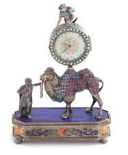 Austrian enameled-silver and gemstone figural desk clock Lot 54