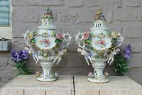 PAIR sitzendorf marked german porcelain vases relief floral decor putti figurine