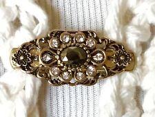 The mattie slender antiqued gold, brown stone and rhinestone flower sweater clip