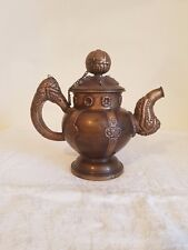 Old Traditional middleastern tea pot made of copper decorated with carvings.