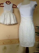 Mother And Daughter Matching Dresses In White For Party Occasion outdoor