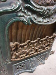 Stufa a gas in ghisa smaltata , antica