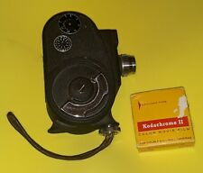 VINTAGE 134 BELL & HOWELL 8MM MOVIE CAMERA AND FILM! - Working