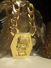 375 YELLOW GOLD CONCAVE LINK NECKLACE WITH PENDANT OF CHILDS HEAD / 129.65 GRAM
