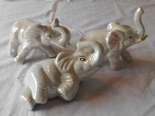 3 ELEPHANT FIGURINES RAISED TRUNKS IRIDESCENT OPAL GLAZE CERAMIC